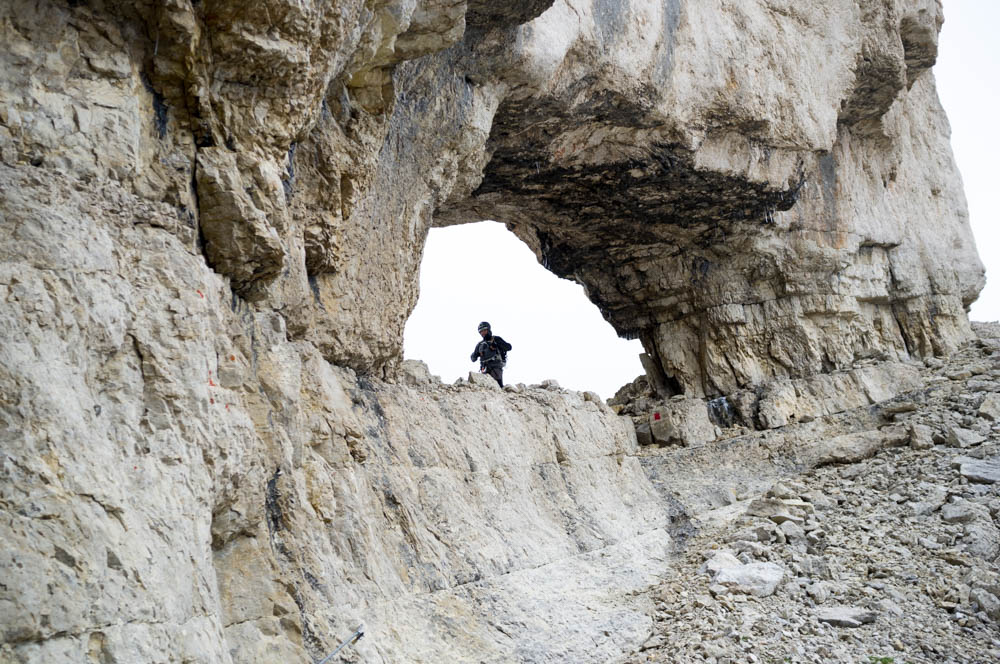 The limestone arch, modelled by a member of the Greek climbing team.