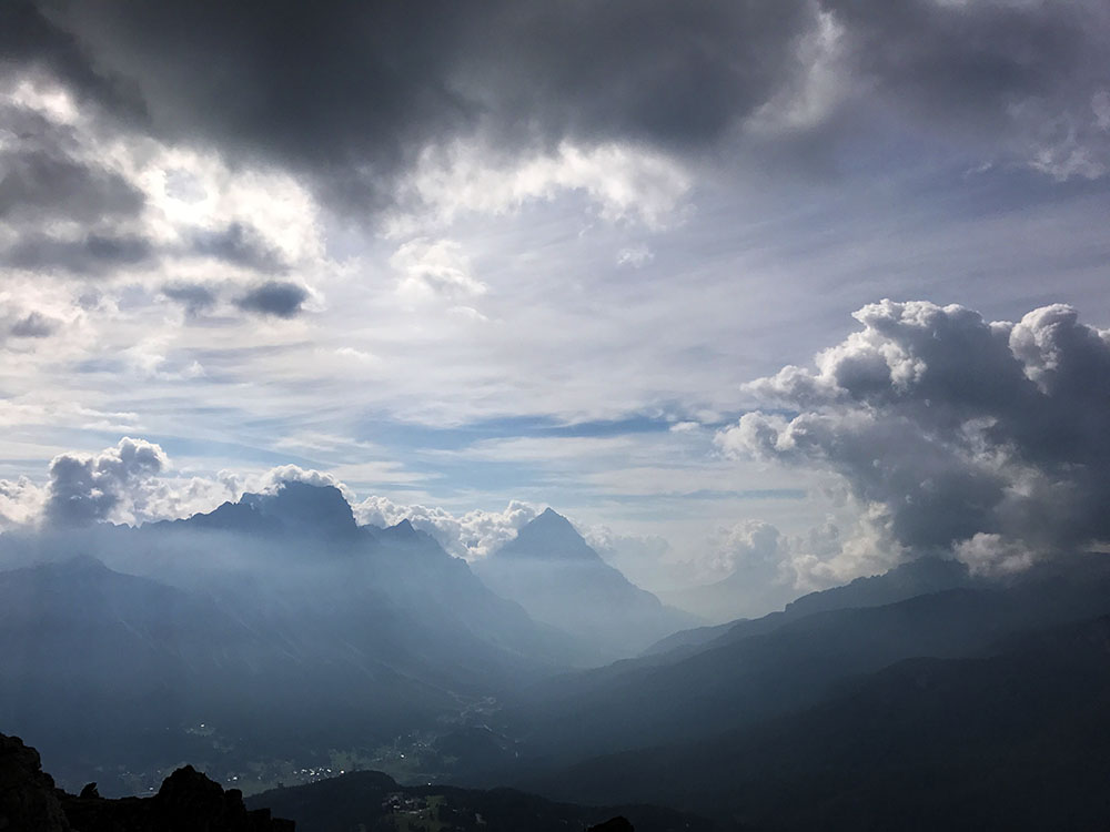 Looking down the valley, with Cortina far below us. Scary clouds form on the peaks.